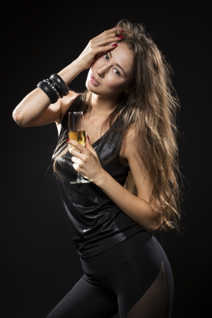 Portrait of glamourous fashion model with glass of champagne. Stock Photo - 20110841