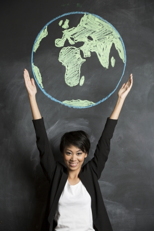 student travel: Asian Business woman or teacher with chalk globe drawn on blackboard