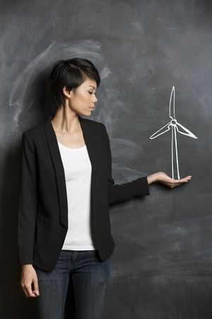 Asian woman standing in front of eco environment sketch on chalkboard   photo