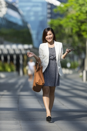 Portrait of a Chinese Businesswoman with bag photo