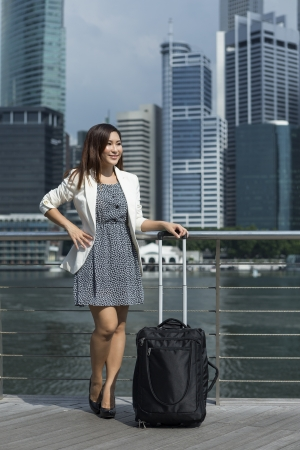 Portrait of a Chinese Businesswoman with suitcase photo