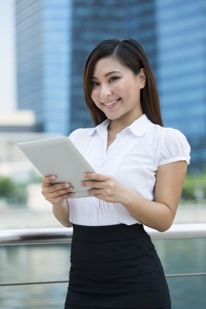 Chinese business woman with a tablet computer. Asian business woman using digital tablet computer. photo