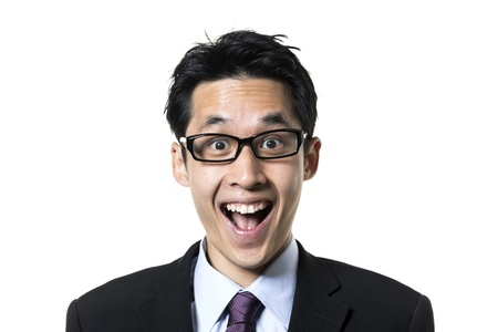 Portrait of an Asian business man looking suprised. Isolated on a white background. photo