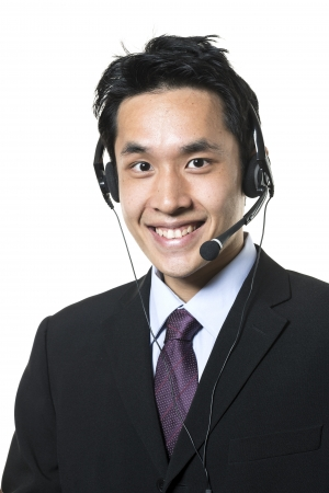 Chinese businessman, call-center agent wearing a headset. Isolated on a white background. photo