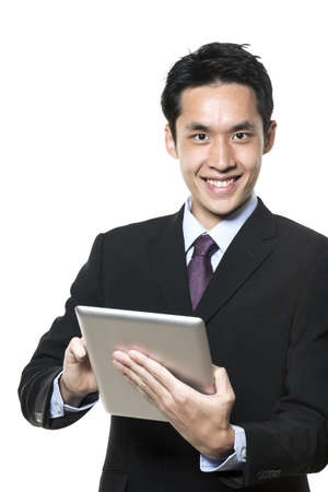Chinese businessman with a tablet computer. Isolated on a white background. photo