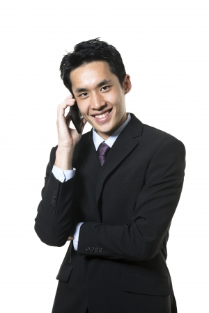 Chinese businessman using a smart phone. Isolated on a white background.  photo