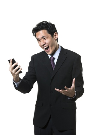 Angry Asian businessman screaming on the phone. Isolated on a white background.  photo