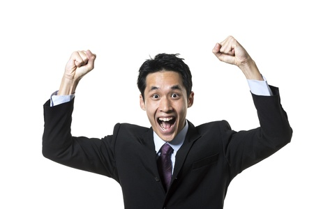excited man: Portrait of a successful Chinese businessman celebrating. Isolated on a white background.