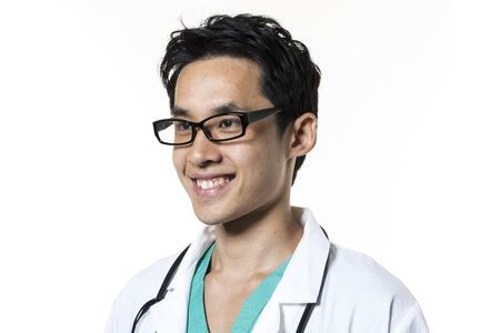 white coat: Portrait of a Male Asian doctor wearing Green Scrubs & white coat. Isolated on white background. Stock Photo