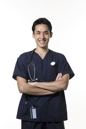 asian nurse: Portrait of a Male Asian nurse wearing dark blue Scrubs. Isolated on white background.