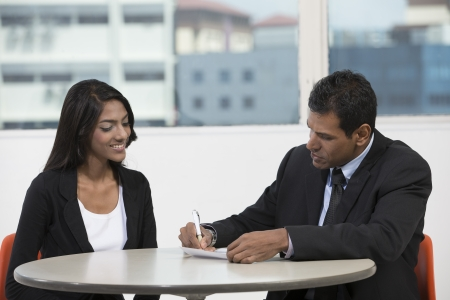 two men: Happy Indian business man and woman having a meeting Stock Photo