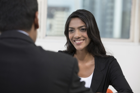 indian business man: Happy Indian business man and woman having a meeting Stock Photo