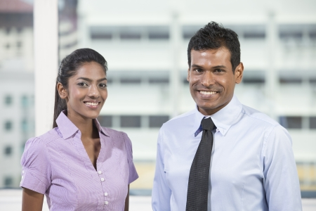 Portrait of two Indian business colleagues standing in the office photo