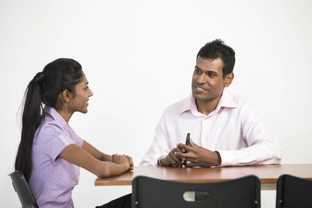 Happy Indian business man and woman having a meeting photo