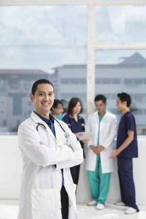 Group of doctors and nurses standing in a hospital. Multi-ethnic team of medical staff. Stock Photo