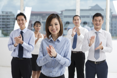 businessteam: A team of business people celebrating. Multi ethnic business team. Stock Photo