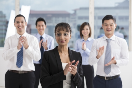 people celebrating: A team of business people celebrating. Multi ethnic business team. Stock Photo