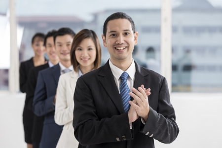 applause: A team of business people celebrating. Multi ethnic business team. Stock Photo