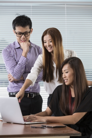 Chinese busines team working together in the office. photo