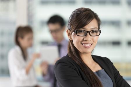 entrepreneurs: Beautiful Asian business woman standing  Stock Photo