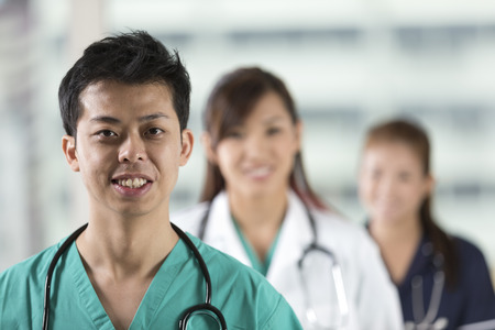 south asians: Asian Medical team of doctors and nurses standing in a hospital.
