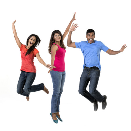 Excited group of Indian men and women jumping for joy. Isolated on white background.