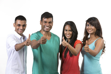 Happy group of Indian friends with thumbs up. isolated over white background. photo