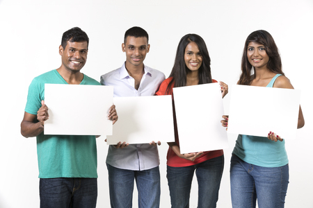 indian student: Group of Indian people with a banner ad. Isolated on white background. Stock Photo