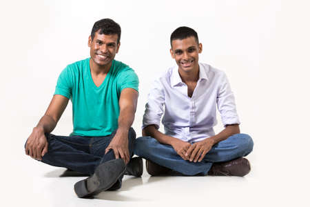 south asian: Two happy Indian male friends. Isolated on a white background. Stock Photo