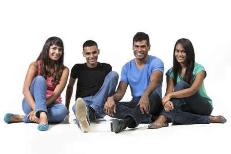 Happy group of Indian friends. Isolated on a white background. photo