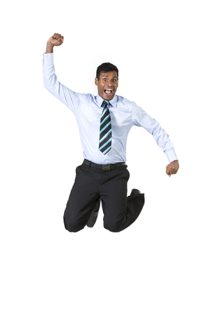 Excited Indian businessman jumping for joy. Isolated on white background. photo