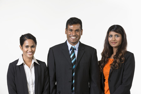 Team of three happy Indian business people. isolated on a white background.