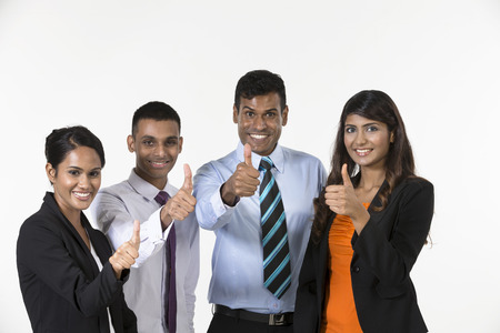 thumbs up group: Team of happy Indian business people with Thumbs Up. Isolated on white background.