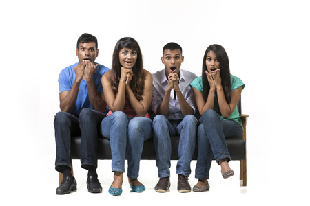 astonished: Shocked and surprised group of Indian friends. Isolated on a white background.