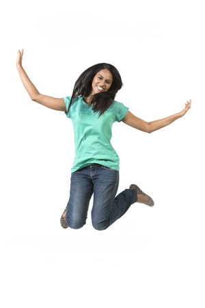 Excited Indian woman jumping for joy. Beautiful Asian woman jumping isolated on white background. photo