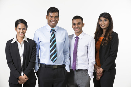 south indian: Team of four  happy Indian business people. isolated on a white background.