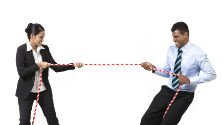 tug: Two Indian business people playing tug war. Isolated on white background