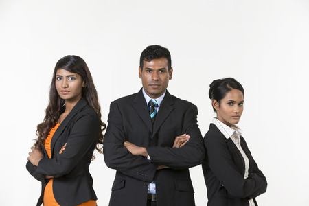 south asian: Team of three happy Indian business people. isolated on a white background.