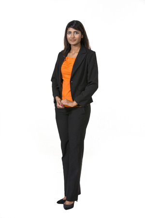 Full length Portrait of a happy Indian business woman. Isolated on a white background. photo
