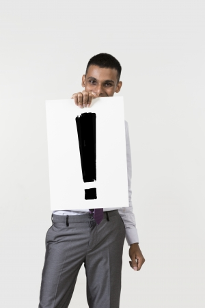 notecard: Indian man holding up a banner with an explanation mark