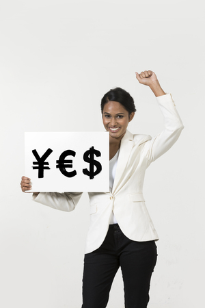indian currency: Indian business woman holding currency symbols saying word YES Stock Photo