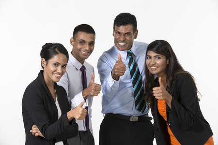Team of happy Indian business people with Thumbs Up photo