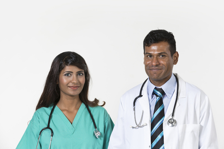 Portrait of two happy Medical Staff.  Isolated on a white background. photo