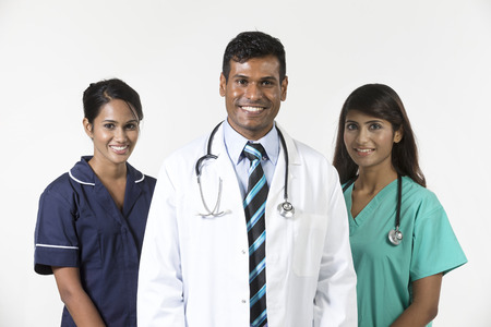 Indian medical team standing on white background photo