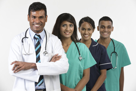 south asians: Indian medical team standing on white background