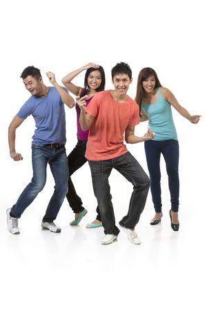 Happy group of Chinese friends dancing. Isolated over white background