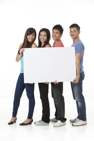 Group of Chinese people with a banner ad. Isolated on white background. photo