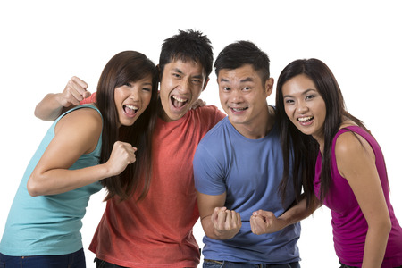 happy crowd: Happy group of Chinese friends celebrating good news. Isolated over white background Stock Photo