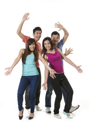 Happy group of Chinese friends dancing. Isolated over white background photo