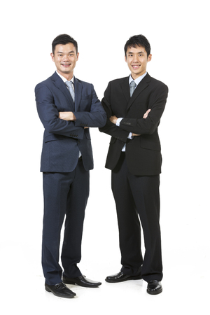 south east: Portrait of a two Chinese Business men. Isolated on a white background.
